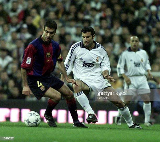 Josep Guardiola of Bacelona turns away from Lusi Figo of Real Madrid during the Real Madrid v FC Barcelona La Liga match played at the Santiago...