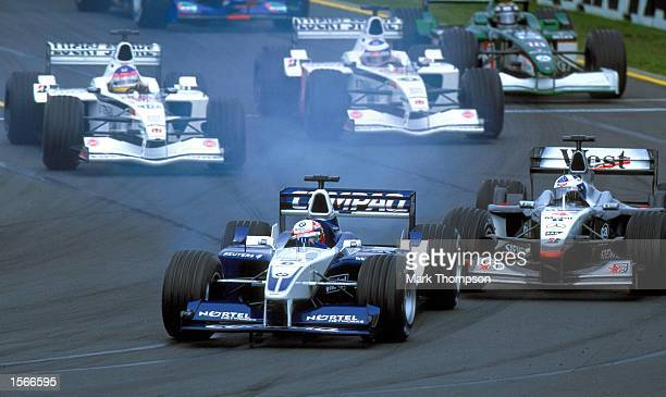 Juan Pablo Montoya of Colombia and the Williams BMW Formula one team locks up the brakes on the first corner during the Australian Grand Prix at the...