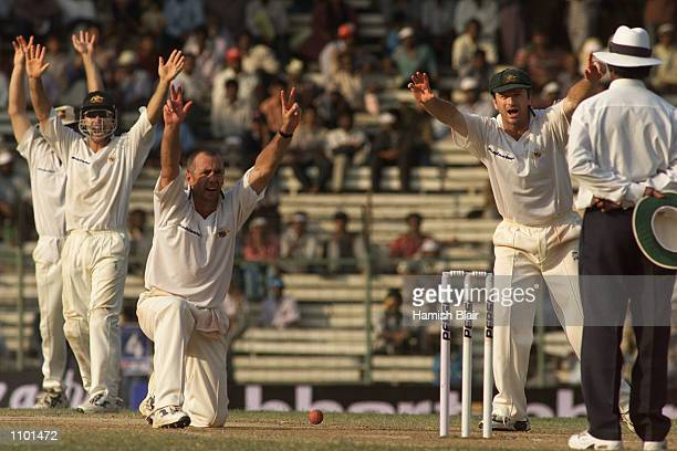 Justin Langer, Colin Miller and Steve Waugh of Australia appeal unsuccessfully for the wicket of Harbhajan Singh of India, during day three of the...