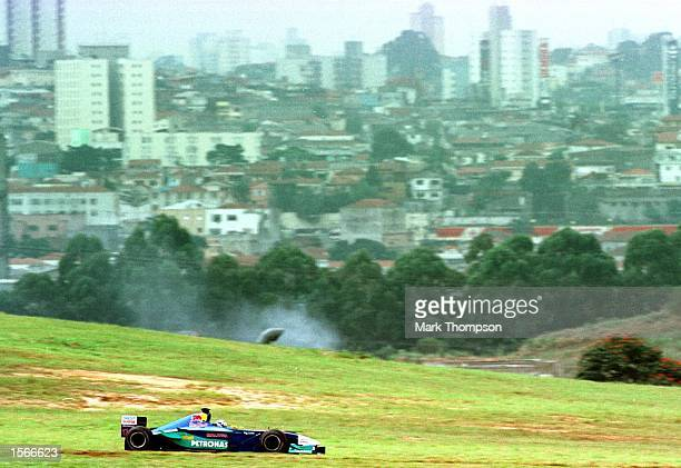 Kimi Raikkonen of Sauber and Finland with the City of Sao Paulo in the background during first practice at the Formula One Brazilian Grand Prix at...