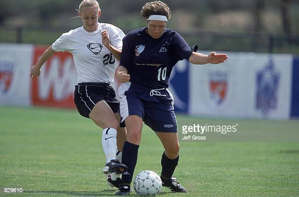 Krista Davey of the DC Freedom fights for the ball against Hege Riise of the Carolina Courage during the Spring Training game at the Arco Olympic...