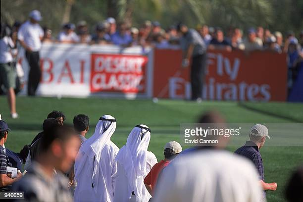Locals watch Tiger Woods of the USA and Thomas Bjorn of Denmark during the Dubai Desert Classic at the Emirates GC in Dubai Mandatory Credit David...