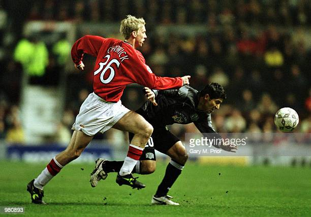 Luke Chadwick of Man Utd clashes with Mehrdad Minavand of Graz during the Manchester United v Sturm Graz UEFA Champions League Group A match at Old...