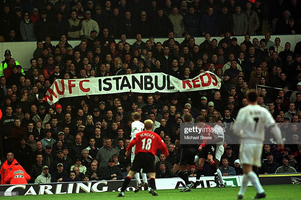 Man Utd fans hold up offencive banner during the Leeds ...