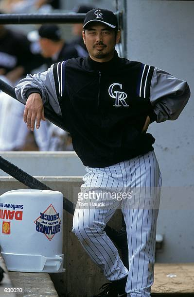 Masato Yoshii of the Colorado Rockies looks on from the dug out during the Spring Training game against the Chicago White Sox at Hi Corbett Field in...
