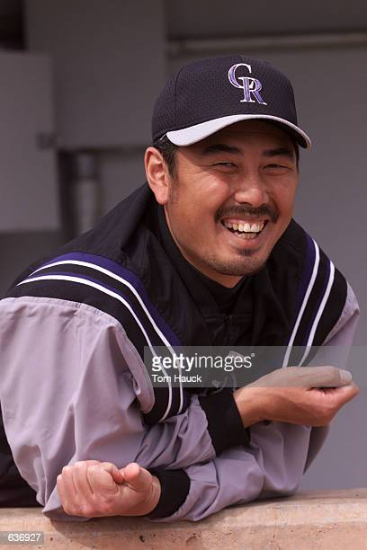 Masato Yoshii of the Colorado Rockies stands in the dugout during their game against the Chicago White Sox at Hi Corbett Field in Tucson Arizona...
