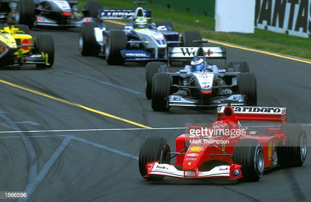 Michael Schumacher of Germany and Ferrari Formula one team leads in to the first corner during the Australian Grand Prix at the Albert Park Curcuit...