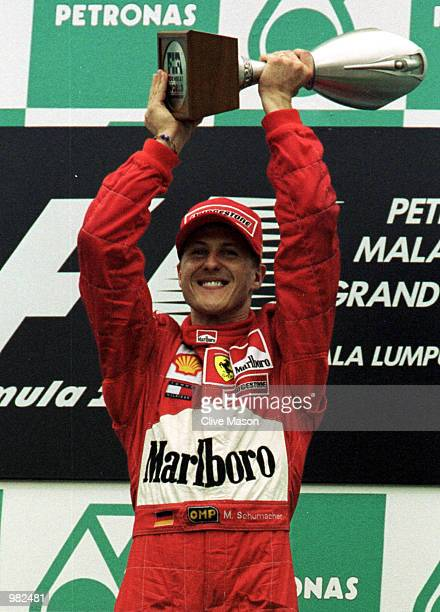 Michael Schumacher of Germany and the Ferrari Formula One Team celebrates his victory at the Malaysian Grand Prix at the Sepang International Circuit...