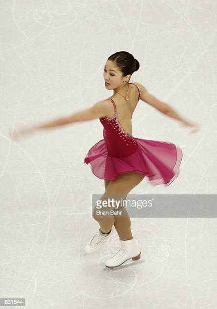 Michelle Kwan of the USA spins during the women's qualifying free skating competition at the 2001 World Figure Skating championships at the GM Place...