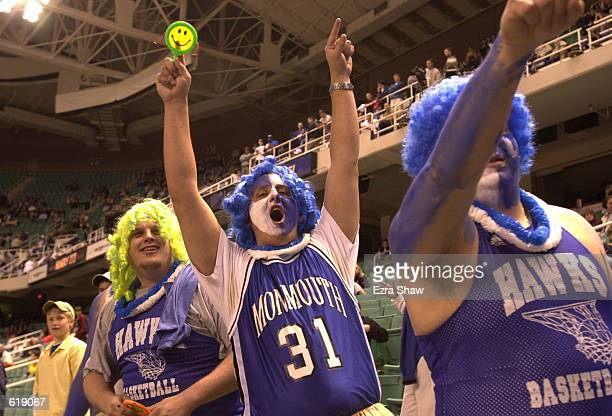 Monmouth fans Jason Cedder center dress for the big dance as their team faces off against Duke in the first round of the Men's NCAA Tournament at the...