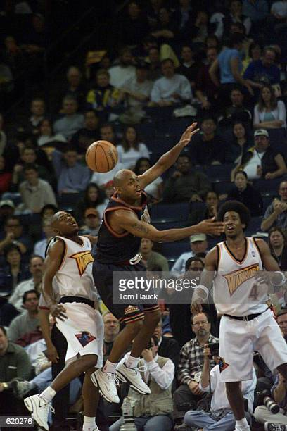 Mookie Blaylock of the Golden State Warriors steals the ball from Nick Van Exel of the Denver Nuggets at the Arena in Oakland during their game in...