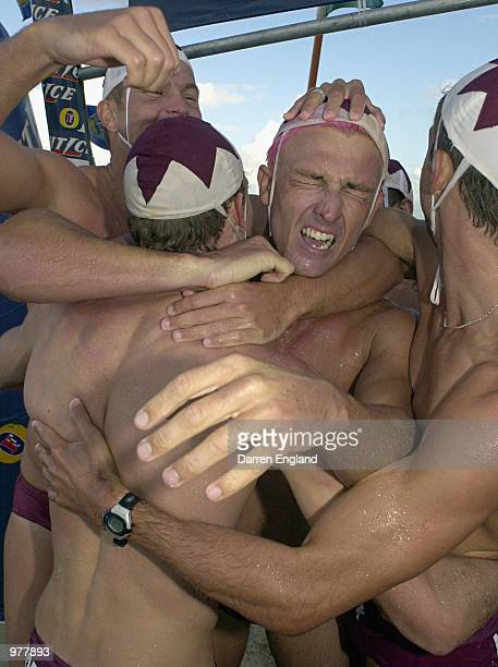 Nathan Baggaley of Northcliffe Surf Lifesaving Club Boat celebrates with team mates after they won the men's Taplin Relay final at the Australian...