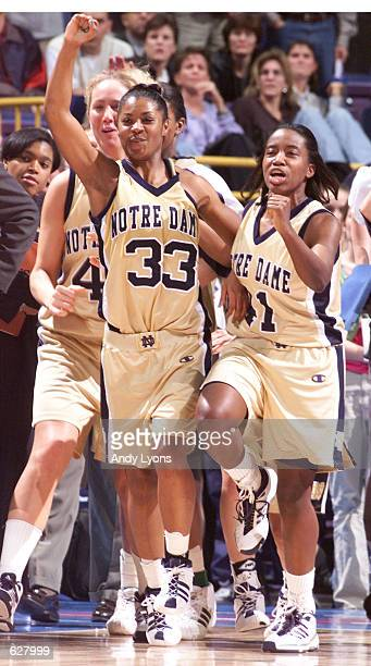 Niele Ivey and Imani Dunbar of Notre Dame celebrate at the end of the semifinals of the NCAA Women's Final Four at the Savvis Center in St Louis...