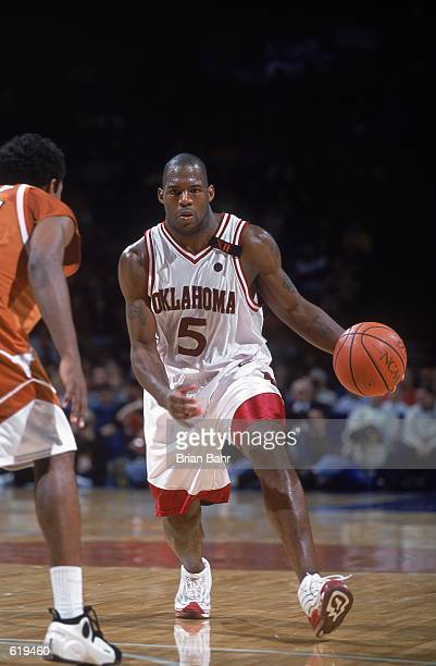 Nolan Johnson of the Oklahoma Sooners moves with the ball during the game against the Texas Longhorns at the Kemper Arena in Kansas CIty Missouri The...