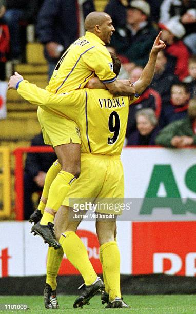 Olivier Dacourt celebrates with Mark Viduka of Leeds during the FA Carling Premiership game between Charlton Athletic v Leeds United at The Valley,...