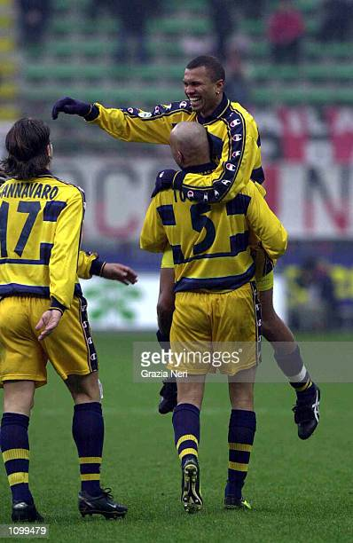 Parma players celebrate a goal during the Serie A 21st Round League match between AC Milan and Parma played at the Giuseppe Meazza San Siro Stadium...
