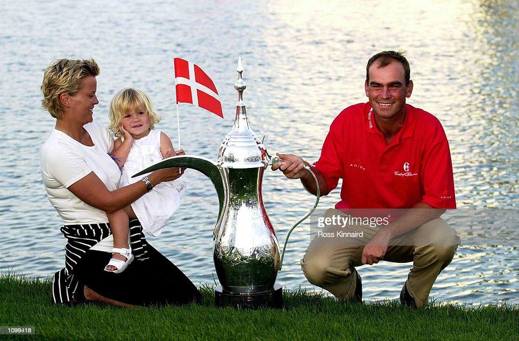 Pernilla and Filippa Bjorn with Thomas Bjorn of Denmark and the winners trophy atter the final round of the Dubai Desert Classic in Dubai . Digital Image. Mandatory Credit: Ross Kinnaird/ALLSPORT