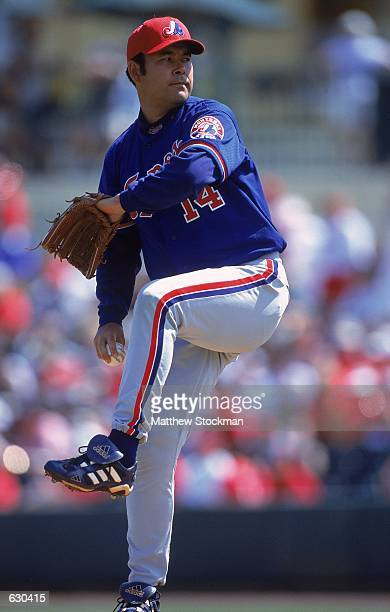 Pitcher Hideki Irabu of the Montreal Expos winds up for the pitch during the Spring Training Game against the St Louis Cardinals at Roger Dean...