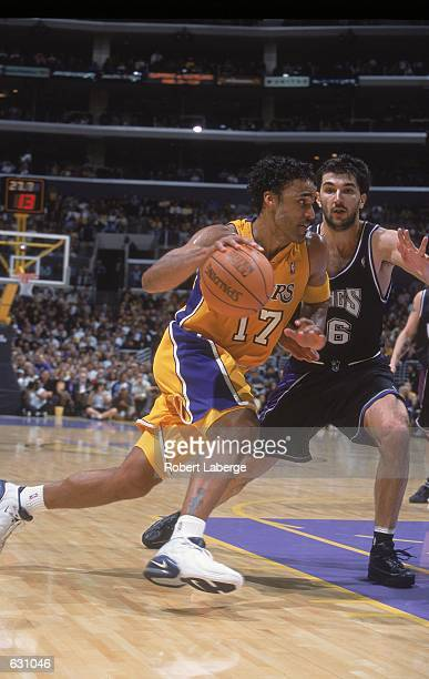 03f7e25d8c8 Rick Fox of the Los Angeles Lakers takes the ball to the basket as he is