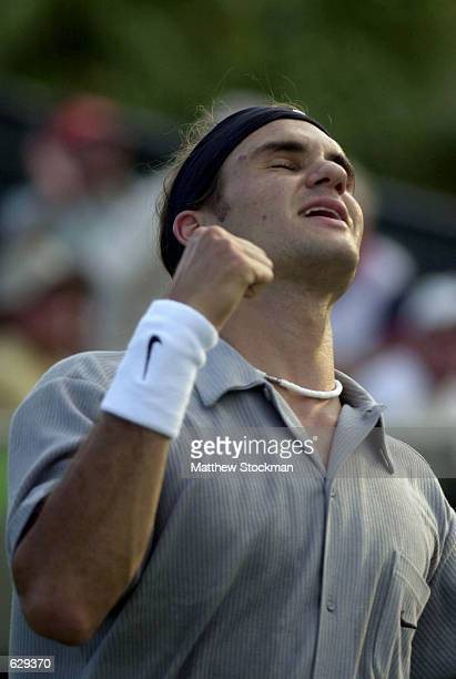 Roger Federer of Switzerland celebrates after defeating Mark Philippoussis of Australia during the fourth round of the Ericsson Open at the Tennis...