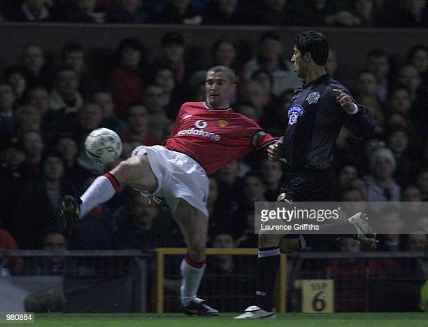 Roy Keane of Man Utd clashes with Mehrdad Minavand of Graz during the Manchester United v Sturm Graz UEFA Champions League Group A match at Old...