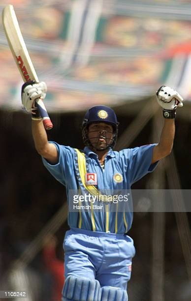 Sachin Tendulkar of India brings up his century, during the 3rd One Day International between India and Australia, played at Nehru Stadium, Indore,...