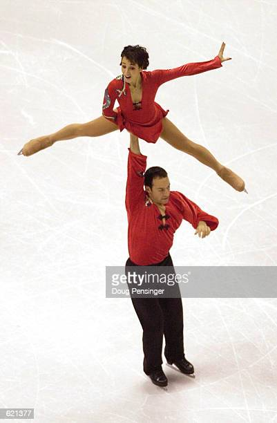 Sarah Abitbol is lifted by her partner Stephane Bernards as they compete for France in the Pairs Short Program at the 2001 World Figure Skating...