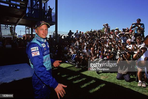 Sauber driver Kimi Raikkonen faces the photographers before the Formula One Australian Grand Prix at Albert Park in Melbourne Australia Mandatory...