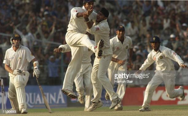 Saurav Ganguly captain of India jumps into team mate Harbhajan Singh's arms as Singh traps Glenn McGrath of Australia LBW to win the test during day...