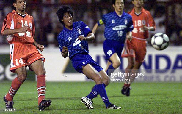 Seo Jung Won of Suwon Samsung Korea drives a powershot at goal while Jose Oscar of Shandong Luneng China looks on during the Asian Club Championship...