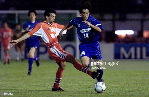 Seo Jung won of Suwon Samsung Korea is tackled by Jose Oscar of Shandong Luneng China during the Asian Club Championship East Asia zone quarter...