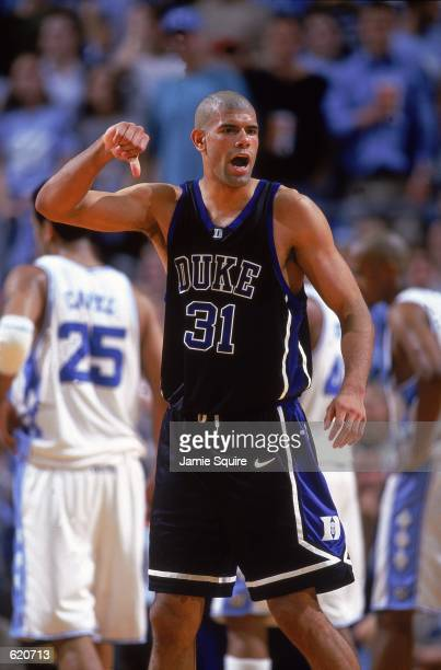 Shane Battier of the Duke University Blue Devils celebrates after the game against the University of North Carolina Tar Heels at the Sean E. Smith...
