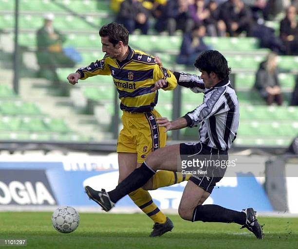 Sottil of Udinese and Micud of Parma in action during the Serie A 23rd Round League match between Udinese and Parma played at the Friuli Stadium...