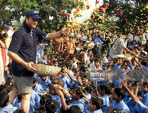 Steve Waugh of Australia throws flower petals over the residents of Udayan Resurection Home Steve Waugh patroned the girls wing of the home which...