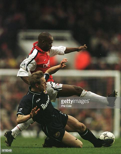 Sylvain Wiltord of Arsenal is tackled by Stuart Pearce of West Ham during the Arsenal v West Ham United match in the FA Carling Premiership at...