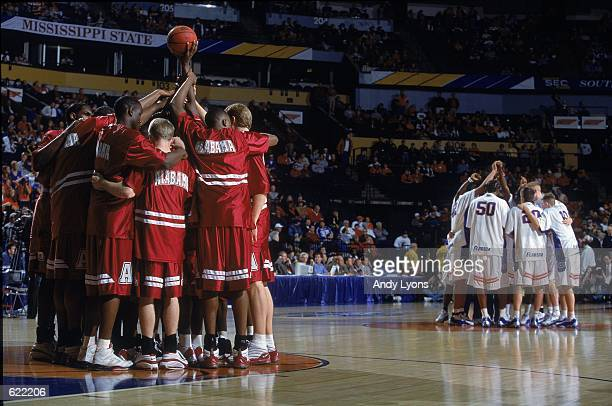 The Alabama Crimson Tide huddles on the court before the SEC Tournament Game against the Florida Gators in Nashville Tennessee The Gators defeated...