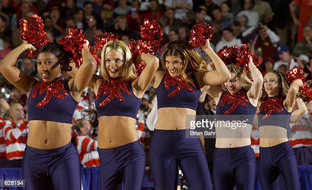 The Arizona cheerleaders perform during the semifinal of the Men's NCAA Basketball Final Four tournament against Michigan State at the Metrodome in...