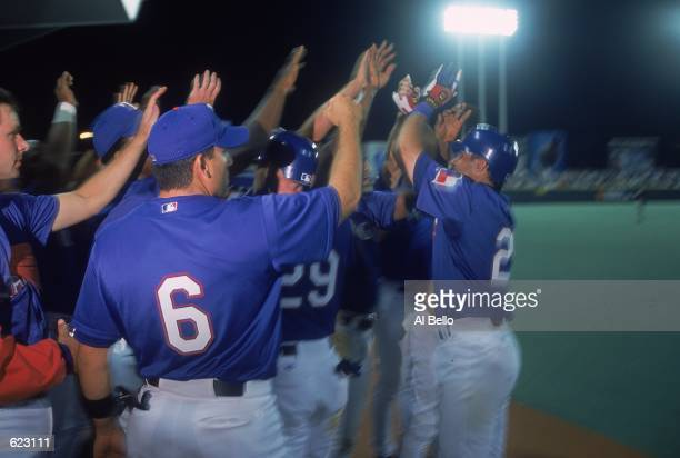The Texas Rangers celebrate after the game against the Toronto Blue Jays at the Hiram Bithorn Stadium in San Juan, Puerto Rico. The Rangers defeated...
