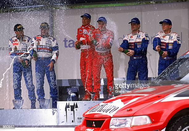 Tommi Makinen and Navigator Risto Mannisenmaki in the Mitsubishi Lancer EVO VI win with Carlos Sainz and Navigator Luis Moya in the Ford Focus taking...