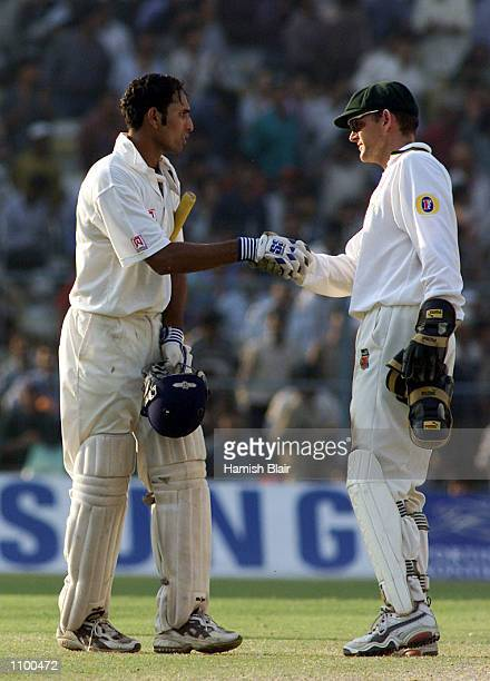 VVS Laxman a of India is congratulated on his innings by Adam Gilchrist of Australia after day four of the 2nd Test between India and Australia...