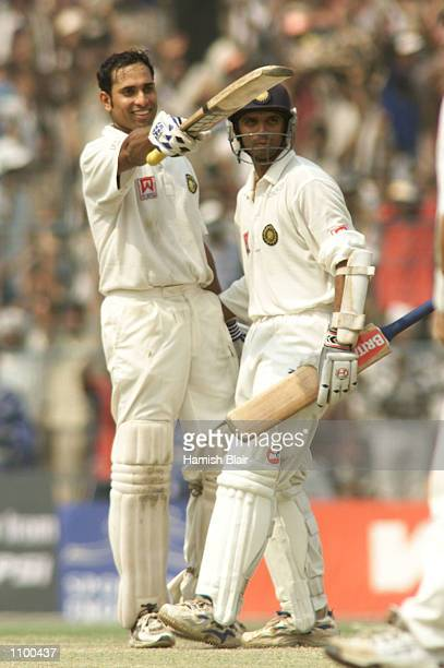 Laxman of India is congratulated by team mate Rahul Dravid after reaching 200, during day four of the 2nd Test between India and Australia played at...