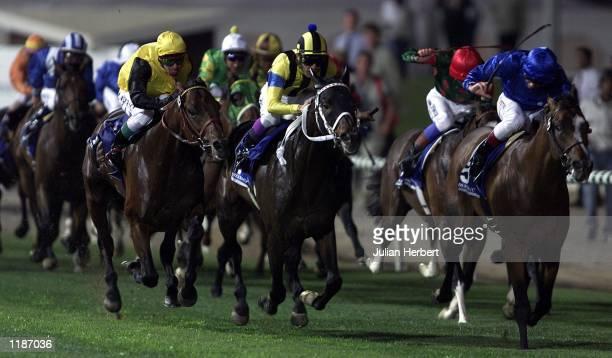 Yutaka Take and Stay Gold come up the centre of Nad Al Sheba racecourse in Dubai to land The Dubai Shhema Classic Mandatory Credit Julian...