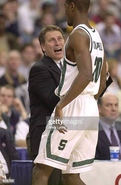 Zach Randolph of Michigan State gets an earful from coach Tom Izzo during their NCAA South Region Final game against Temple at the Georgia Dome in...