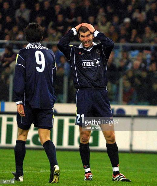 Zinedine Zidane of Juventus with hands on his head watches Filippo Inzaghi during the Serie A 23rd Round League match between Lazio and Juventus...