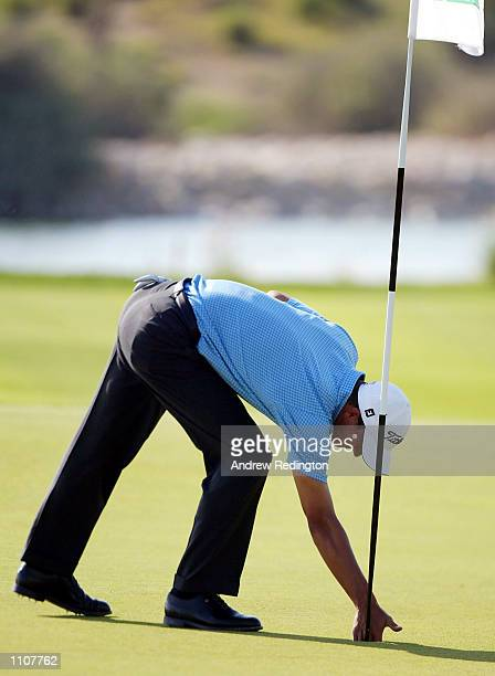 Adam Scott of Australia retrieves his ball from the cup after holing his second shot for an eagle on the 15th hole during the second round of the...