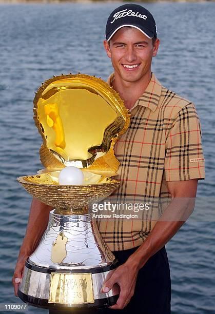 Adam Scott of Australia with the trophy after winning the Qatar Masters Doha Golf Club Qatar DIGITAL IMAGE Mandatory Credit Andrew Redington/Getty...