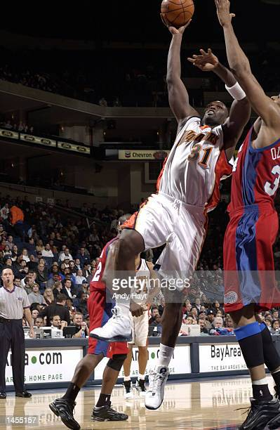 Adonal Foyle of the Golden State Warriors shoots the ball against the Los Angeles Clippers at The Arena in Oakland California DIGITAL IMAGE NOTE TO...