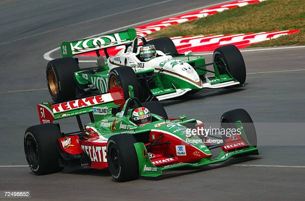 Adrian Fernandez of the Fernandez Racing Team drives his Honda Lola around Paul Tracy's Honda Reynard during the first qualifying session of the...