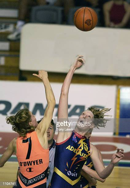 Alison O''Dwyer for Sydneyand Tracey Braithwaite for Adelaide contest a jump ball in the Women's National Basketball League preliminary final between...