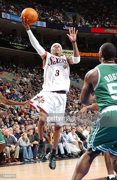 Allen Iverson of the Philadelphia 76ers flies to the hoop as Rodney Rodgers of the Boston Celtics comes over to defend at the First Union Center in...